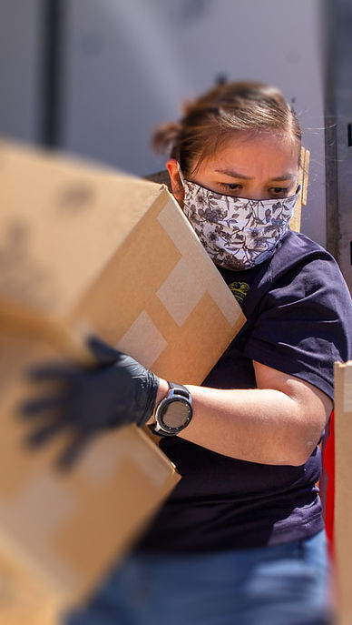 navajo women unloading vert.jpg