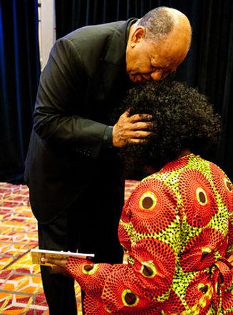 Bishop Kirby Praying over member