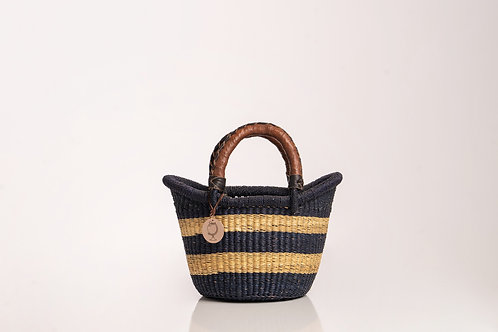 Mini straw handwoven basket with leather handles. Sustainable home decor