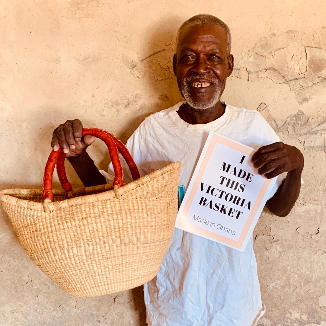 old man holding a basket and smiling