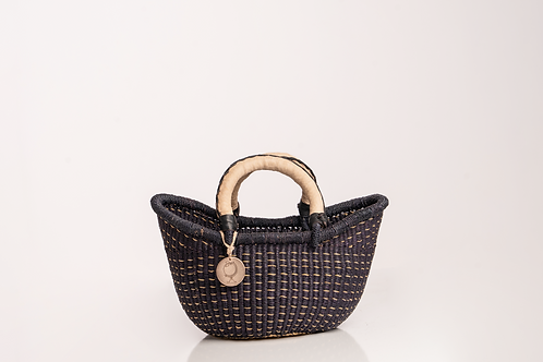 Black extra small straw basket with leather handles. Sustainable Homegoods