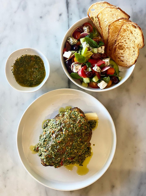 Slow Roasted Confit Lamb Shoulder with Chimichurri & Greek Salad