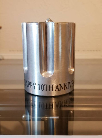 Aluminum cylinder marked with LaserBond 100.  Photo Credit: Ediger's Laser Design