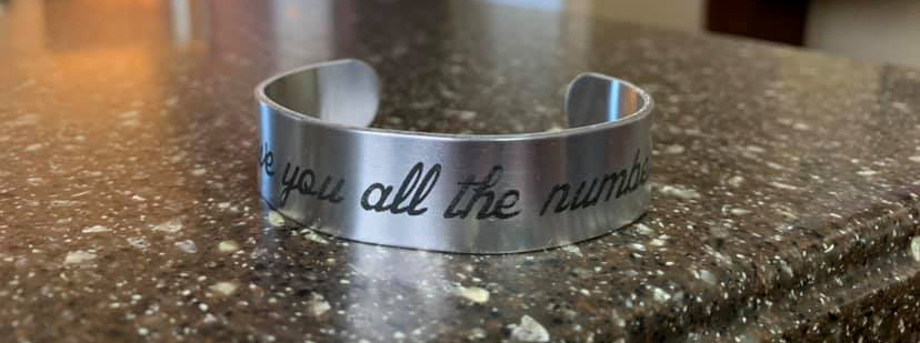 Aluminum bracelet marked with LaserBond 100.  Photo Credit: Blue Cat Creations