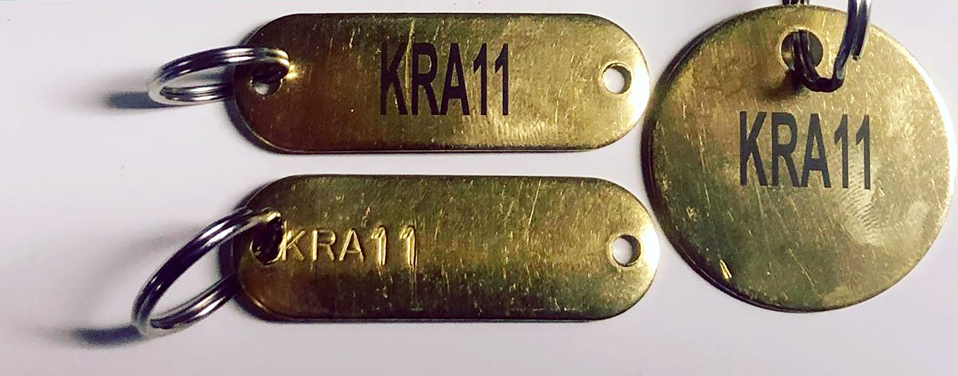 Brass key tags marked with LaserBond 100.  Photo Credit: Rolgany & Sons