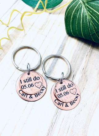 Copper penny keychains marked with LaserBond 100.  Photo Credit: CJ Tangles Jewelry
