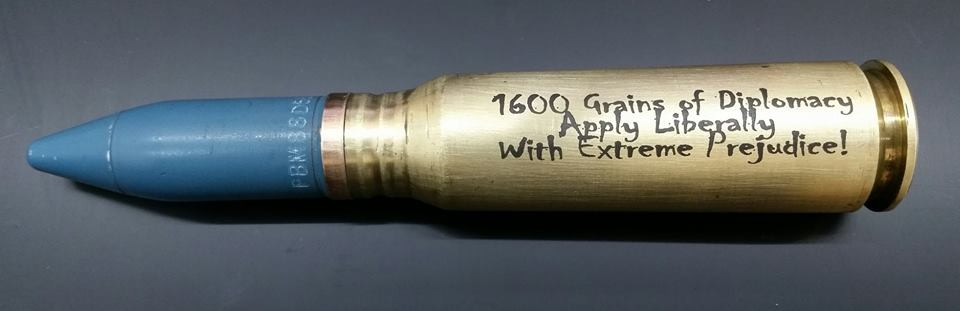 Brass shell marked with LaserBond 100.   Photo Credit: Custom Lazer Creations