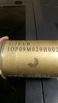 Brass shell marked with LaserBond 100.  Photo Credit: Mag's Creations LLC