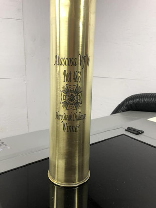 Brass shell marked with LaserBond 100.  Photo Credit: M. Wilke