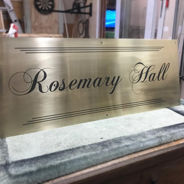 Brass plaque marked with LaserBond 100 for Carnegie Hall Ingersoll.  Photo Credit: Jack Pine Woodworks