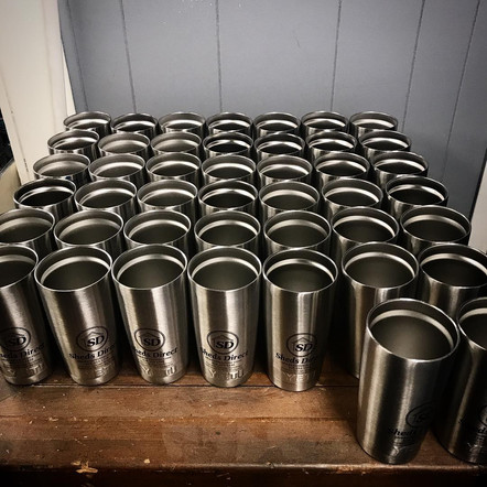 Stainless steel tumblers marked with LaserBond 100.  Photo Credit: Etched Laser