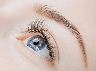 Eyelash extension procedure. Beautiful female eyes with long lashes, closeup._edited.jpg