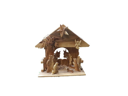 Olive wood nativity sit with music