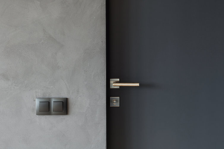 Light switch on the gray textured wall n
