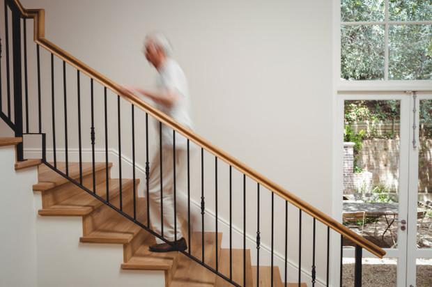senior-man-walking-up-stairs_107420-6363
