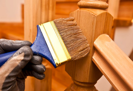 painter-paints-varnish-wooden-board-by-b