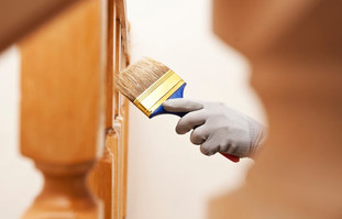 woman-paints-varnish-wooden-board-by-bru