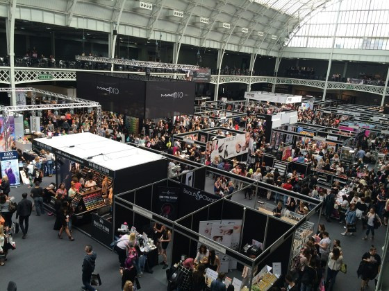 This is an image of an event of what looks like people at an event with booths.