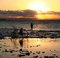 man_fishing_beach_sunset.jpg