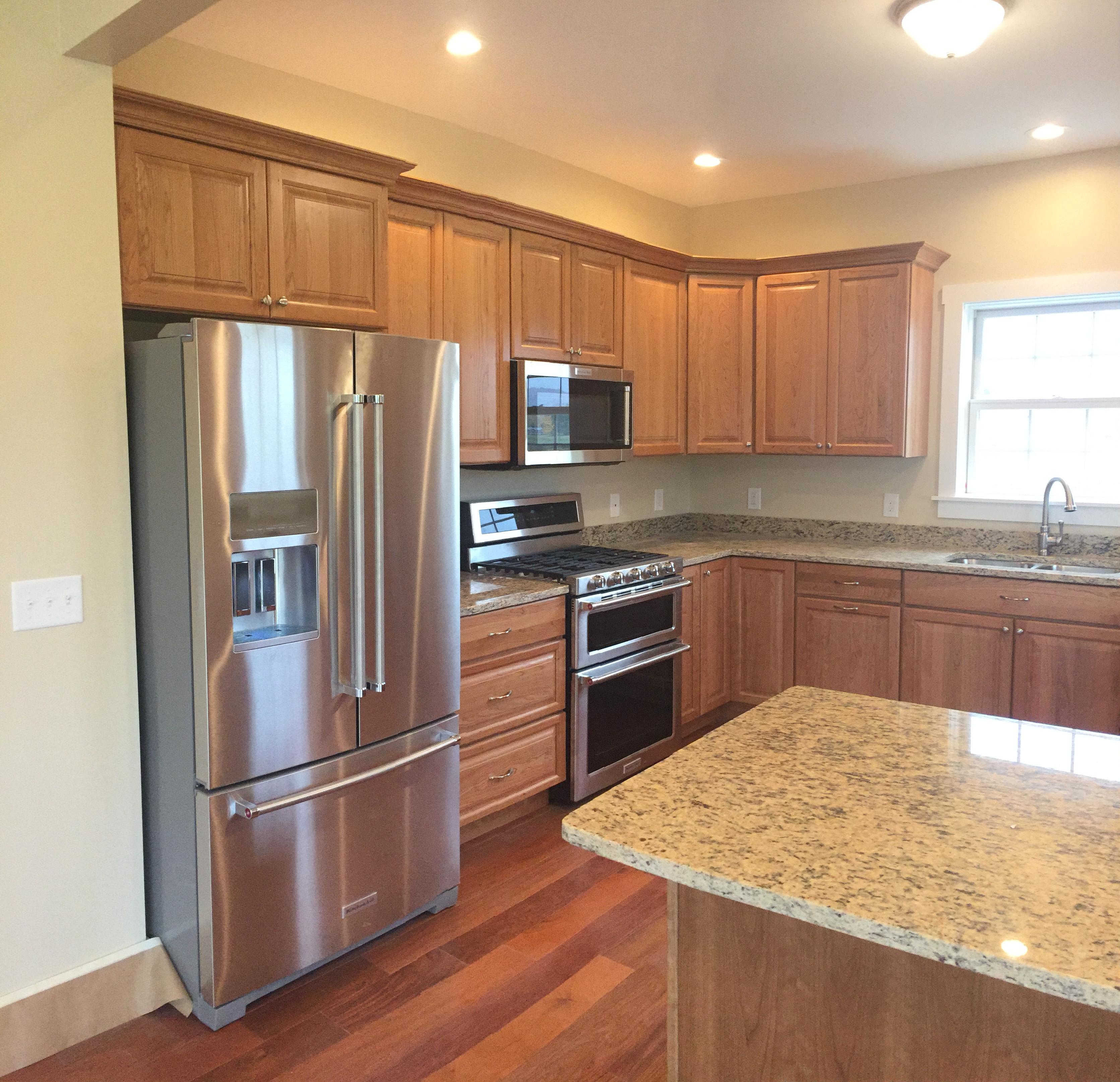 Cherry kitchen and granite top