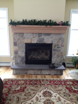 Stone fireplace with cherry mantel