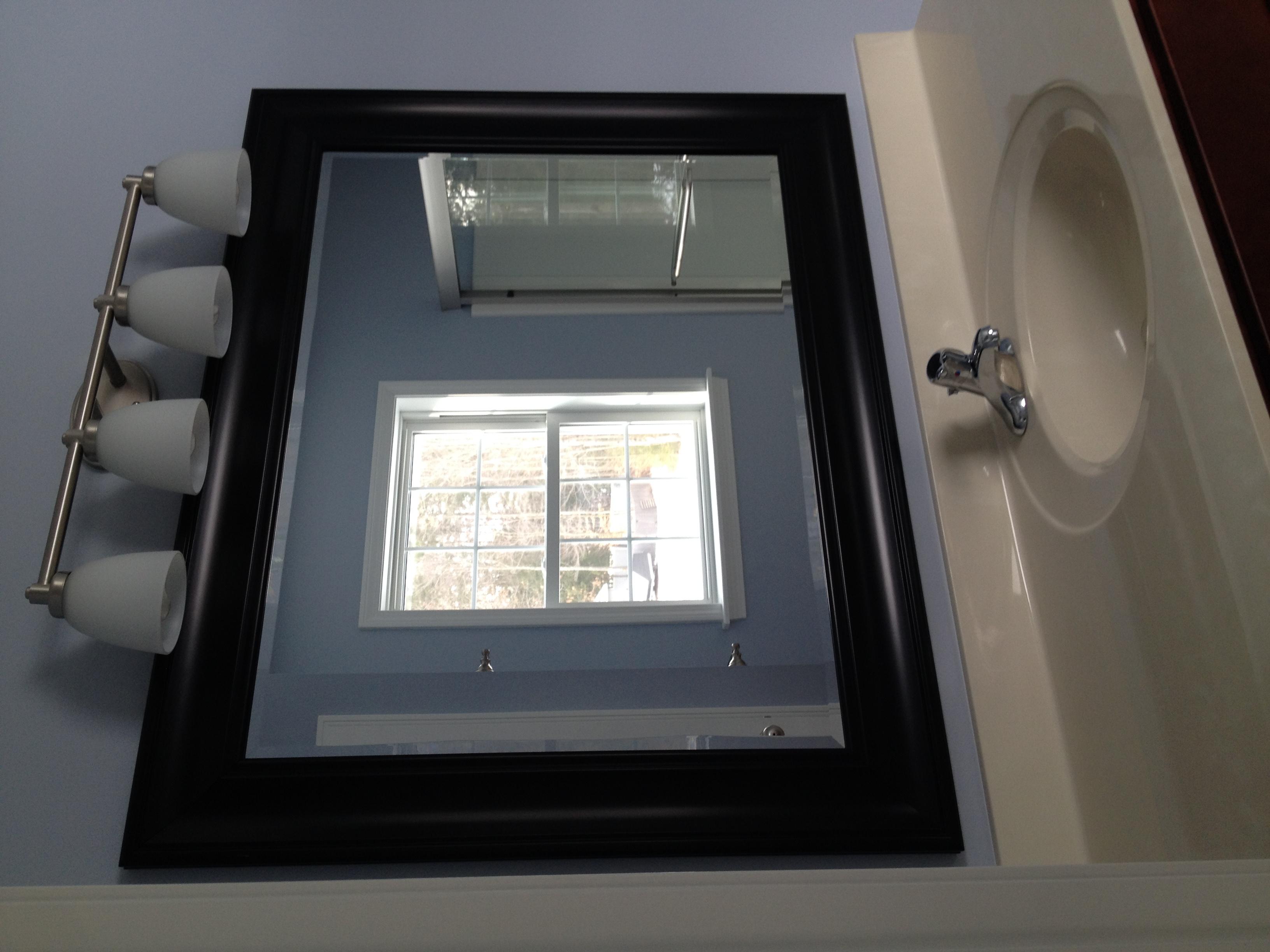 Bathroom mirror and light