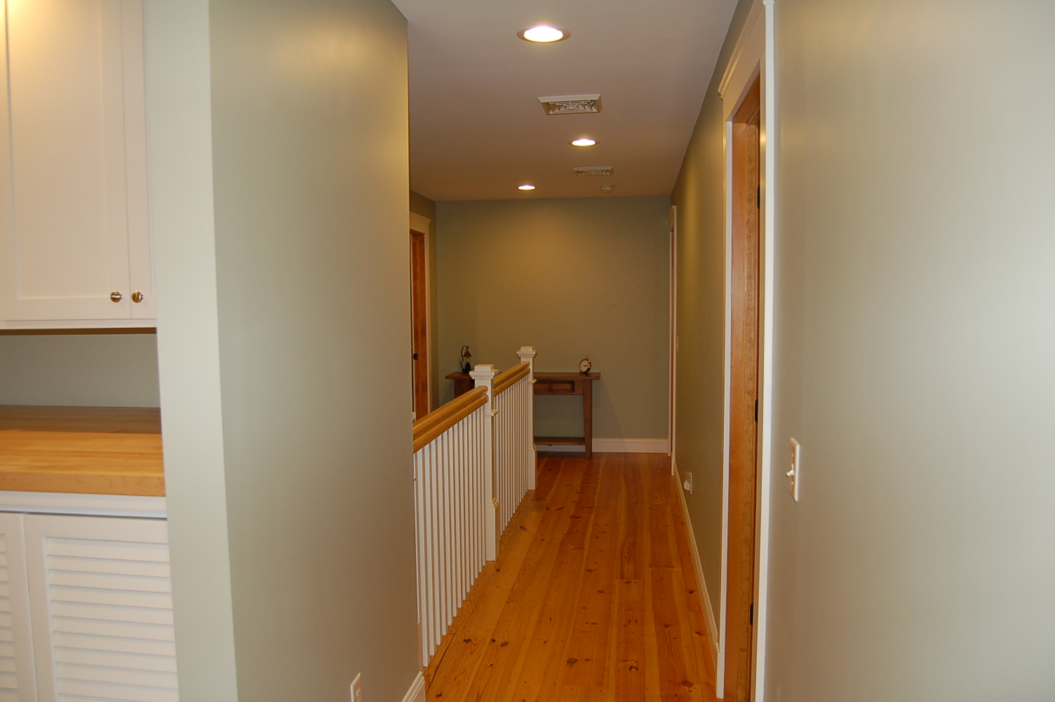 Upstairs hall with pine floors
