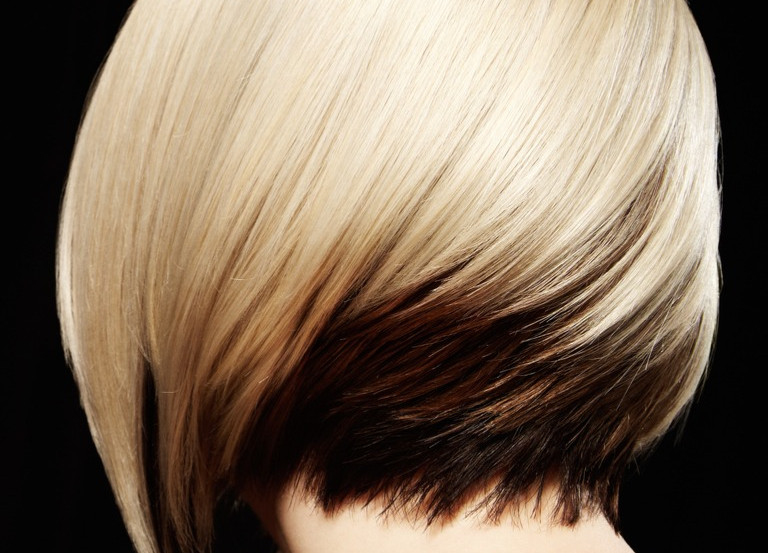 rear-view-of-woman-with-twotoned-hairstyle-black-background-picture-id157616097.jpg