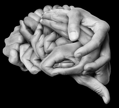 Human brain made with hands, different hands are wrapped together to form a brain. Black b