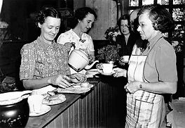 slq-110169-serving-tea-at-the-community-