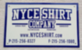 Nyce Shirt Company sign next to the front door.