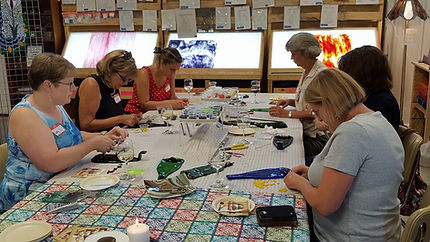 Stained glass class attendees enjoying the creative process.