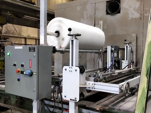 Applicateur de filet (mesh dispensers) pose un filet de protection sur divers produits
