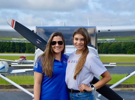 FLYT employees Olivia Pierce and Maddie Warner before Maddie's first solo flight.