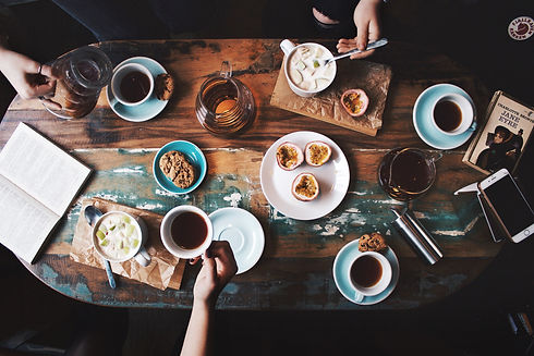 person-sitting-near-table-with-teacups-a