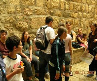 Friday morning activity at David's city – Left: Gila in Nikbat Hashiloah. Right: part of the group at the exit  Standing: Part of Gila, Omer, Nir and Shani's back and Nir's sister, Shunit, Guide and Nirel. Sitting: Elad and Michal