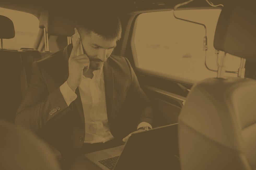 handsome-business-man-working-computer-car.jpg