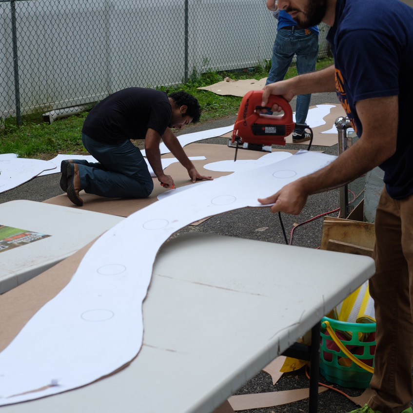 Cutting each layer out of wood before the event.