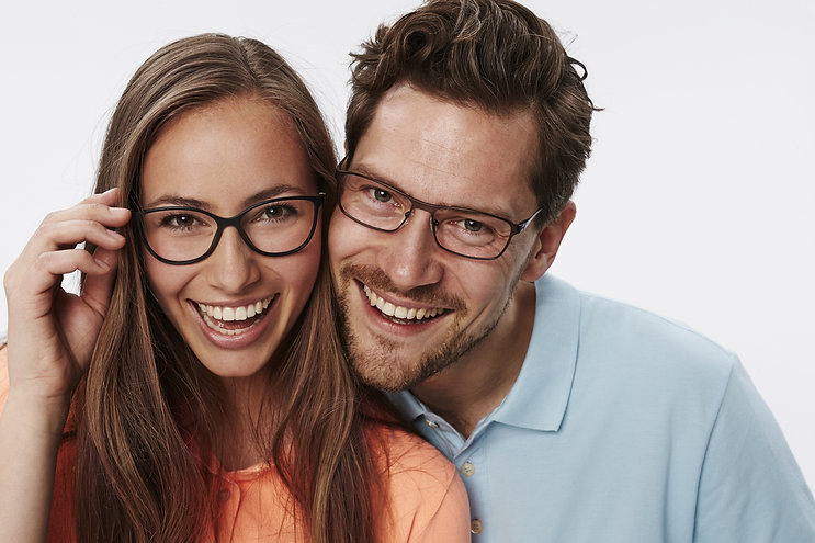 Portrait of couple wearing glasses, stud