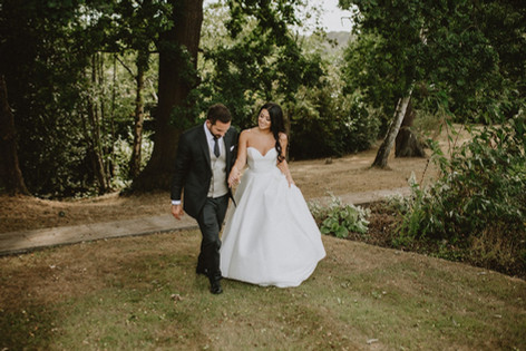 41_L&R_Wedding_Couple_Walking_Garden-min