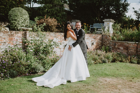 36_L&R_Wedding_Couple_Cheeky_Squeeze-min