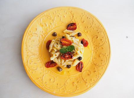 Garganelli con crema di melanzane e ricotta con olive taggiasche e pomodori confit