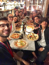group having pizza.jpeg