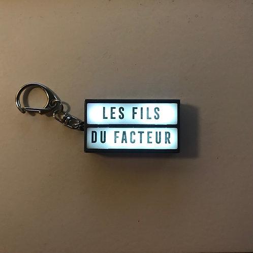 """Porte clé lumineux """"les Fils du Facteur"""""""