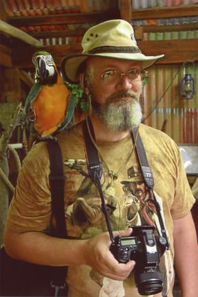 Репетитор по английскому и живой попугай где-то на Майорке.