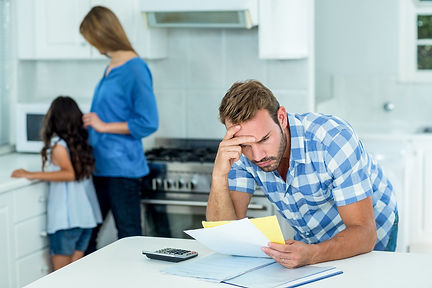 worried father paying bills.jpg