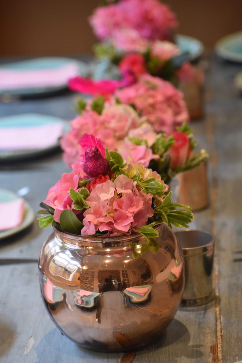 Table setting and flower arrangements