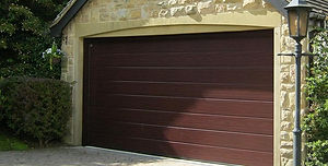 Dark oak foil finish sectional electric garage door