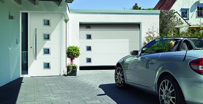 Sectional electric garage door with square glass panels