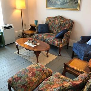 Comfortable living room with original painted wood floors & trim.